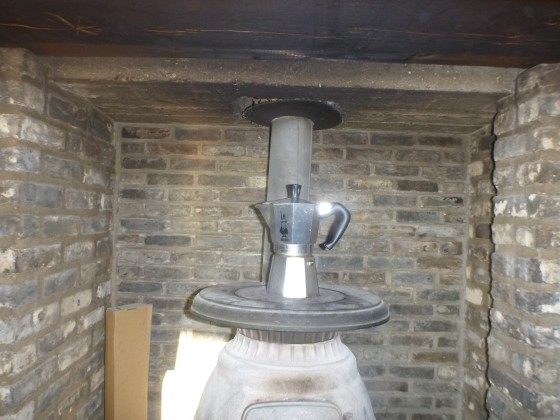Brewing coffee on a wood burning stove
